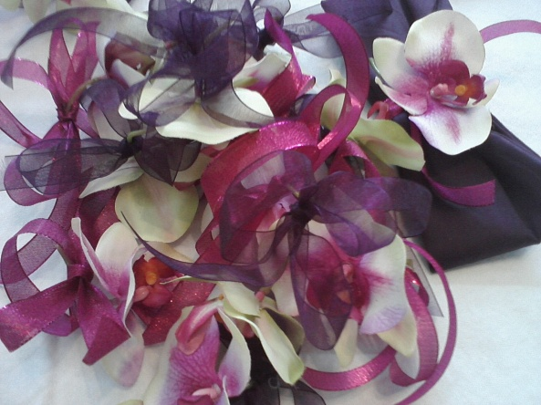 Silk Orchids were used with ribbons to tie on napkins